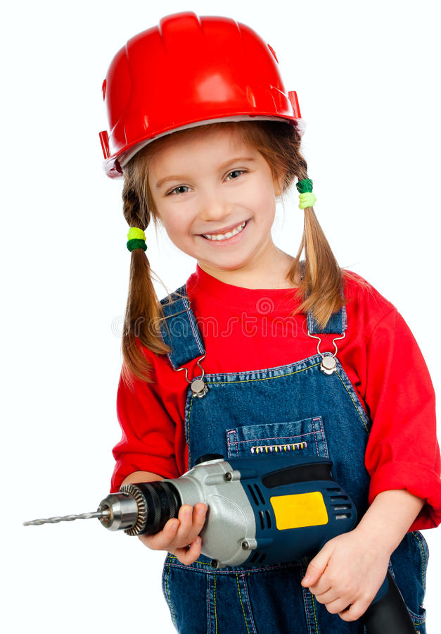 Girl in the construction helmet with a drill. Ittle girl in the construction helmet with a drill on a white background stock images