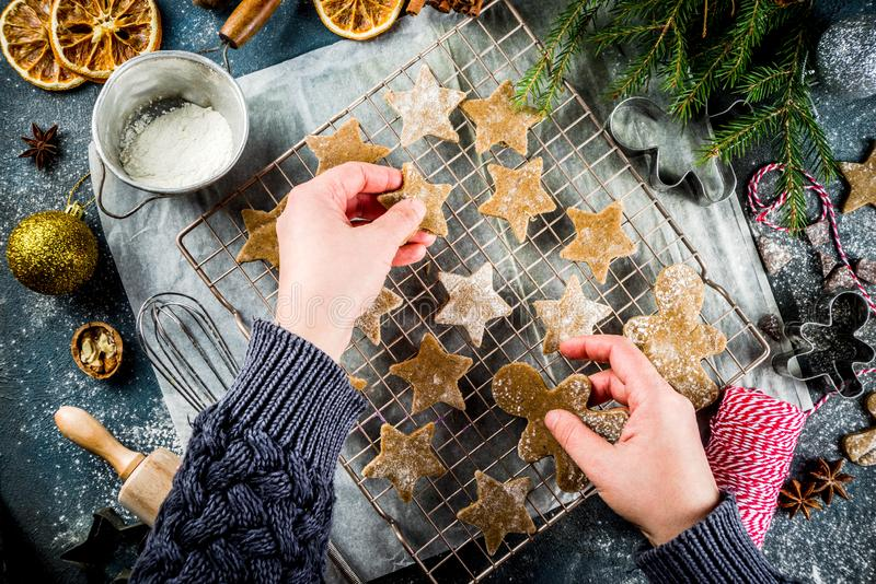 Making gingerbread cookie. Girl cooking christmas homemade gingerbread star cookies, gingerbread men, flat lay, top view, with accessories ingredients for baking stock photo