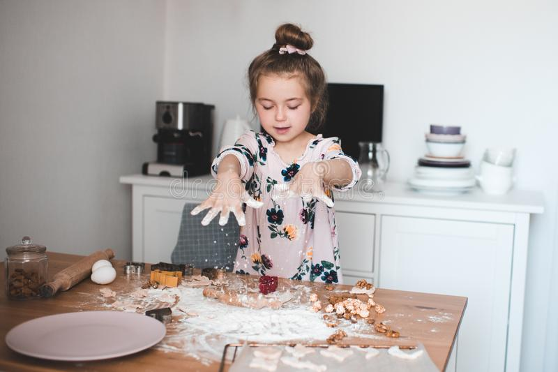 Girl cooking at kitchen stock images