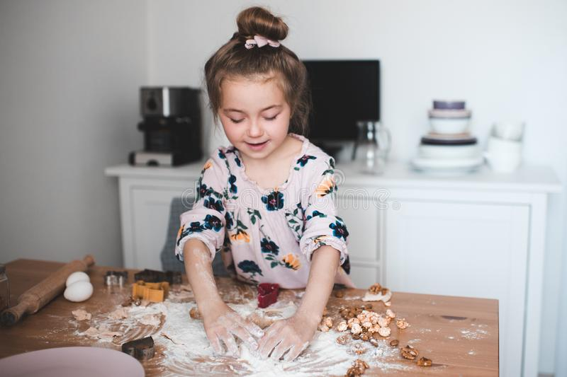 Girl cooking at kitchen royalty free stock image