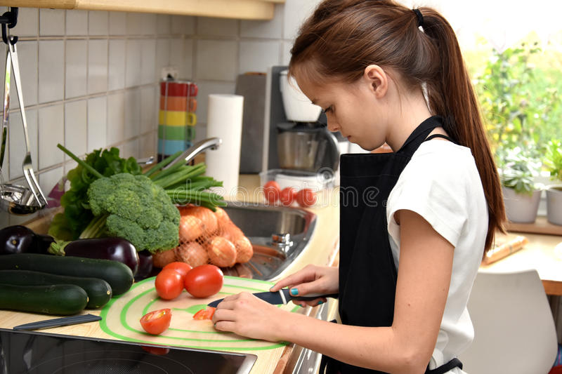 Girl cooking royalty free stock photos
