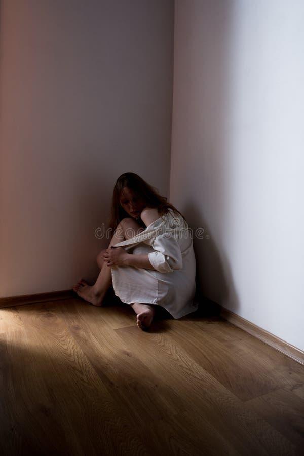 Girl in corner stock photos