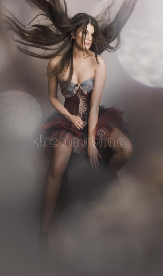 A girl in a corset flying royalty free stock photo