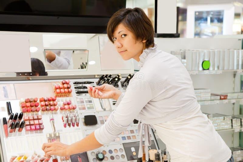 Girl at cosmetics shop royalty free stock image