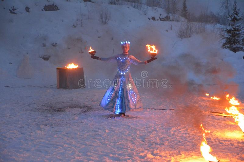 girl cosplaying snow queen holding a fire wrap in her hand, Republic of Karelia, Ruskealla mountain park, 07/01/2019 stock image