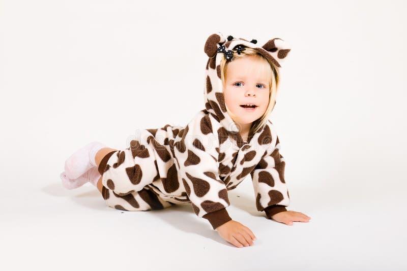 Girl in costume of giraffe stock image
