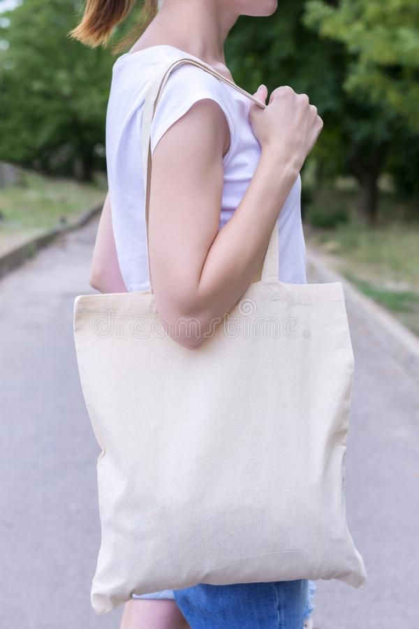Girl with cotton bag over her shoulder stock photography