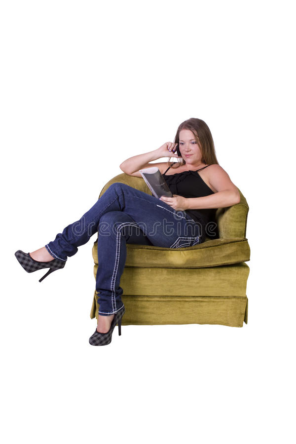 Download Girl On The Couch Reading A Magazine Stock Photography - Image: 17647102