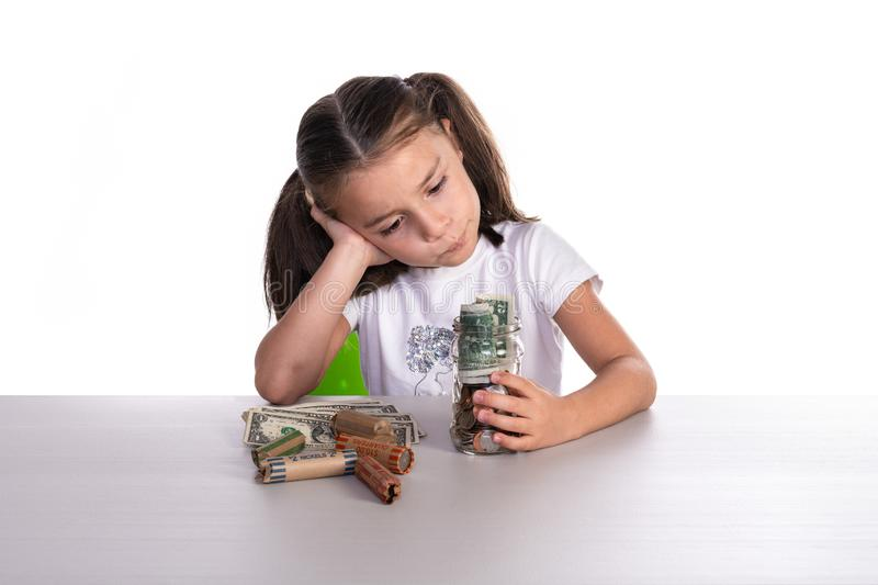 Girl Counting Piggy Bank Savings royalty free stock photos