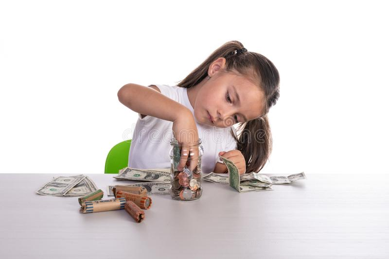 Girl Counting Piggy Bank Savings stock photo