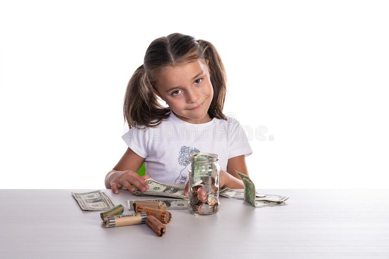 Girl Counting Piggy Bank Savings stock photography