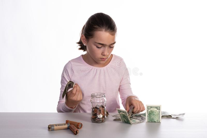 Girl Counting Piggy Bank Savings royalty free stock photography