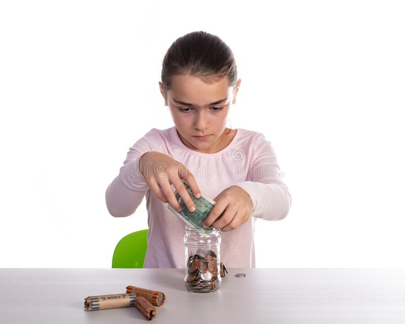 Girl Counting Piggy Bank Savings stock images