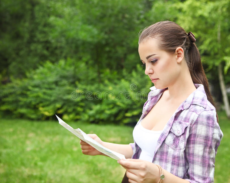 Download Girl In The Countryside Holding A Map Stock Photo - Image: 25456212