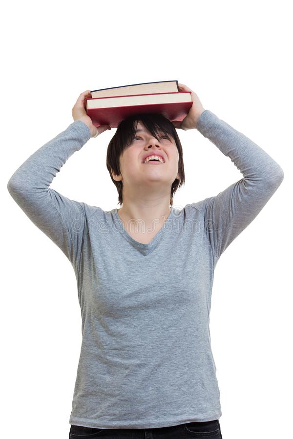 Girl cover head with books stock images