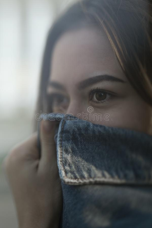 Ð¡overed face with a denim jacket royalty free stock images