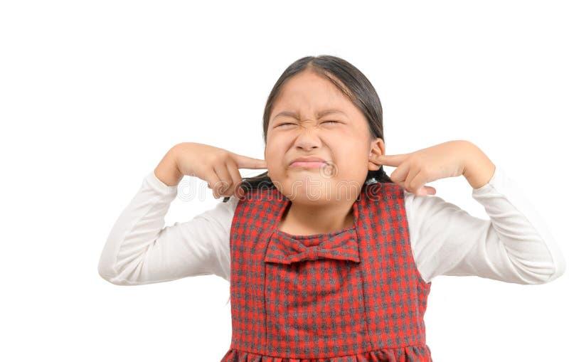 Girl covering ears ignoring annoying loud noise stock photo