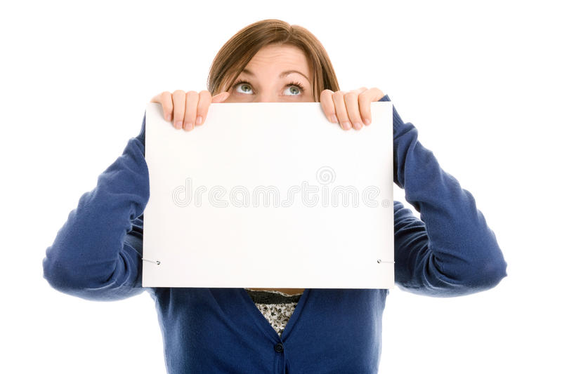 Girl covering face with blank note card royalty free stock photos