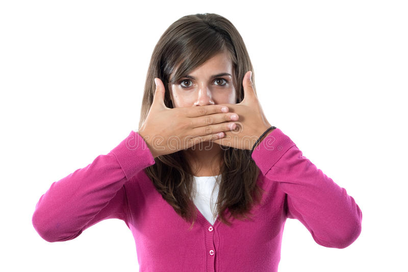 Girl covering her mouth. Girl dressed in pink covering her mouth on a white background stock images