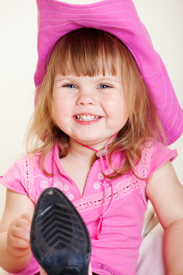 Girl in cowboy hat. Cheerful girl in pink cowboy hat royalty free stock photos
