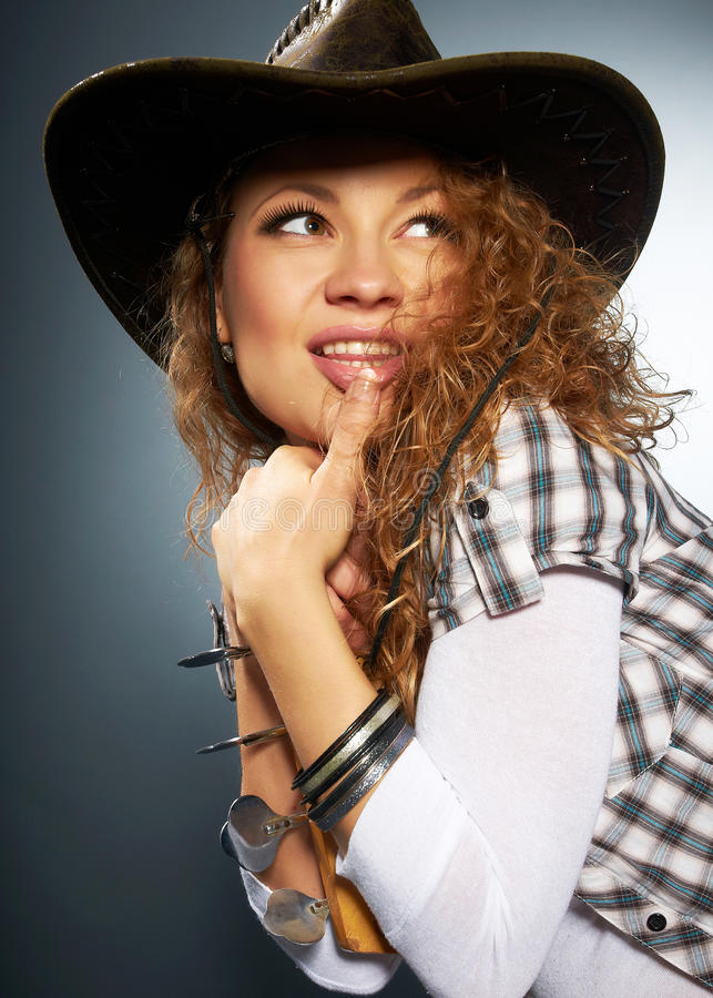 Girl in a cowboy hat stock photo
