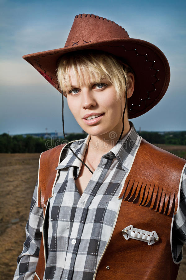 Girl with cowboy hat. Summer time royalty free stock photos