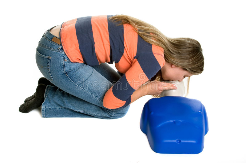 Girl CPR Training. Beautiful isolated girl cpr training royalty free stock photo
