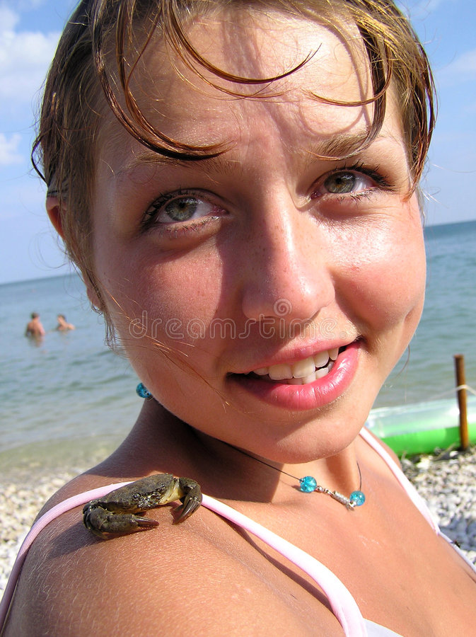 Girl with a crab on a shoulder stock photos