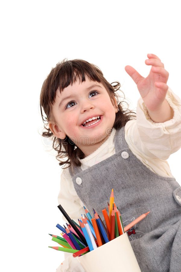 Girl with crayons stock photo