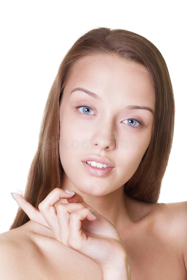 Girl with cream. Portrait of a beautiful girl with smooth skin and cream on a finger on isolated white stock photos