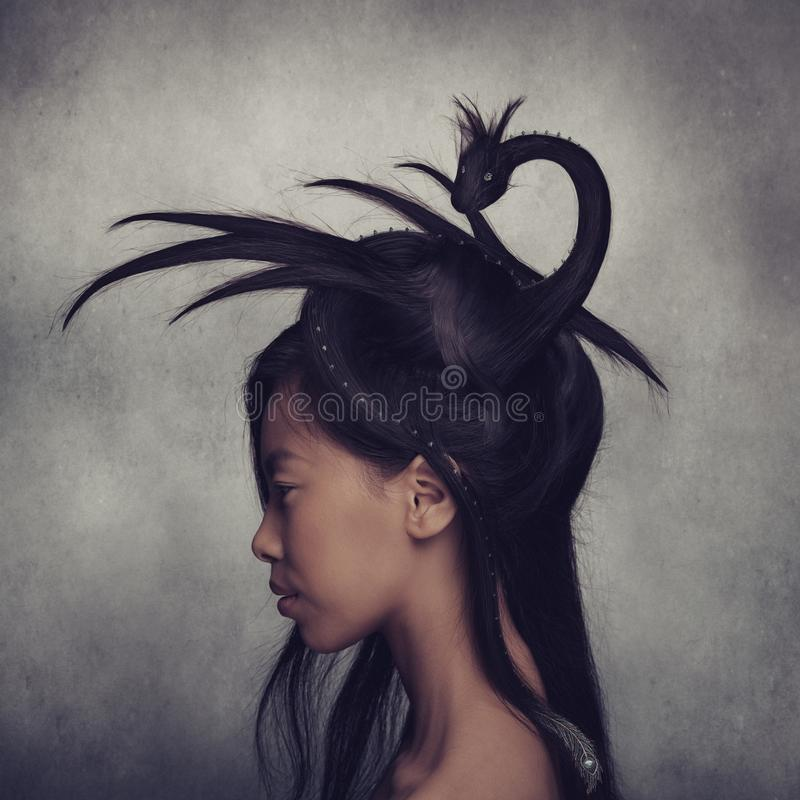 Girl with creative dragon hairstyle stock image