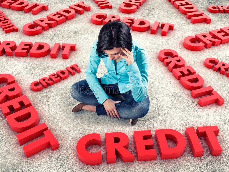 Girl among credits. Sad girl sits among many red credits stock photography