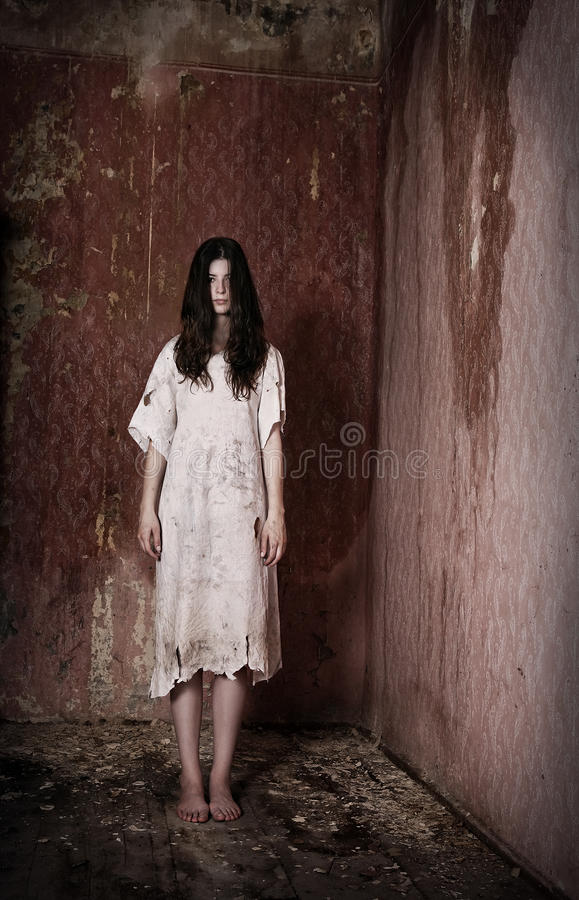 Girl in creepy house. Horror style image - alone girl in creepy house