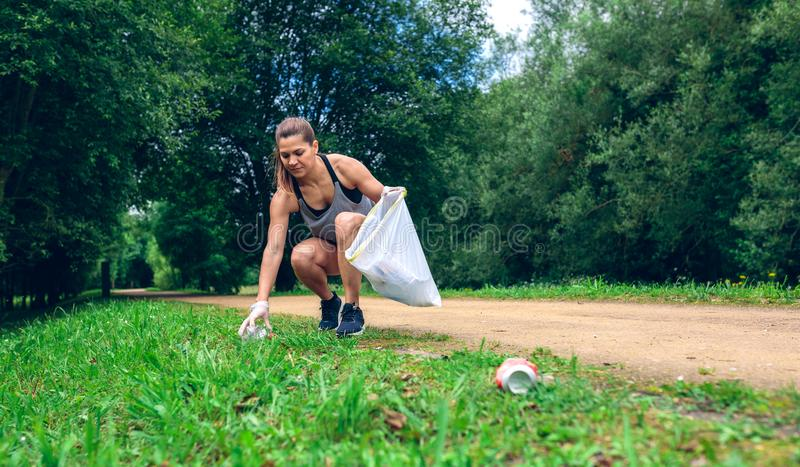 Girl with garbage bag doing plogging stock images