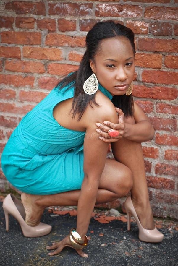 Girl crouching two