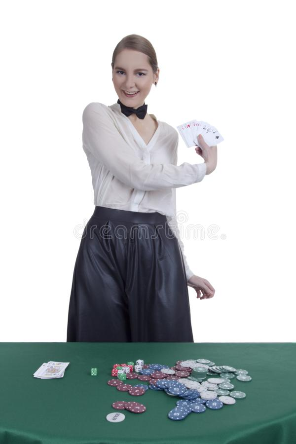 Girl croupier in a casino. Croupier`s girl in casino on white background stock images