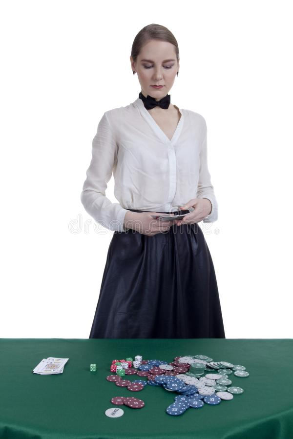 Girl croupier in a casino. Croupier`s girl in casino on white background royalty free stock photo