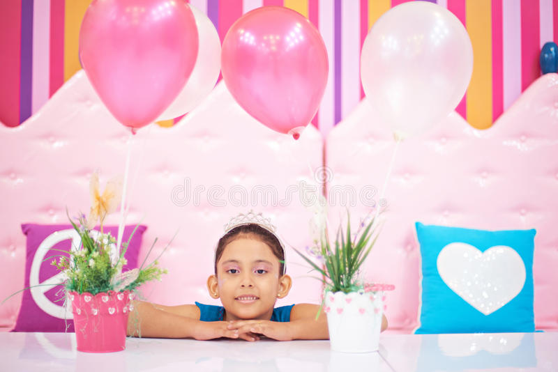 Girl with crown in birthday party stock image