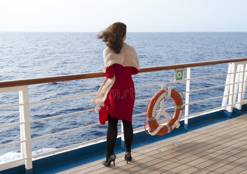 Girl Cruising In Caribbean. The lady in red dress enjoying the view of Caribbean Sea stock images