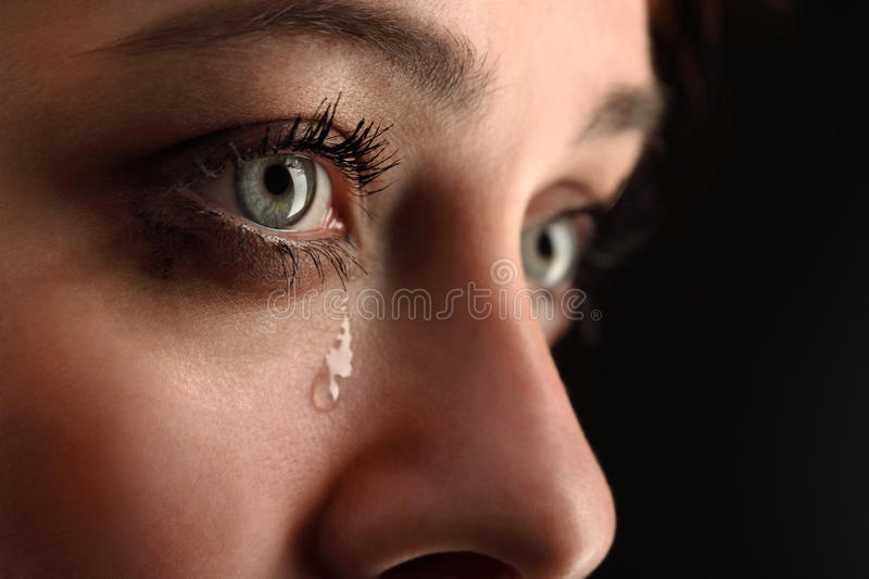 Girl cry. Beauty girl cry on black background royalty free stock photography