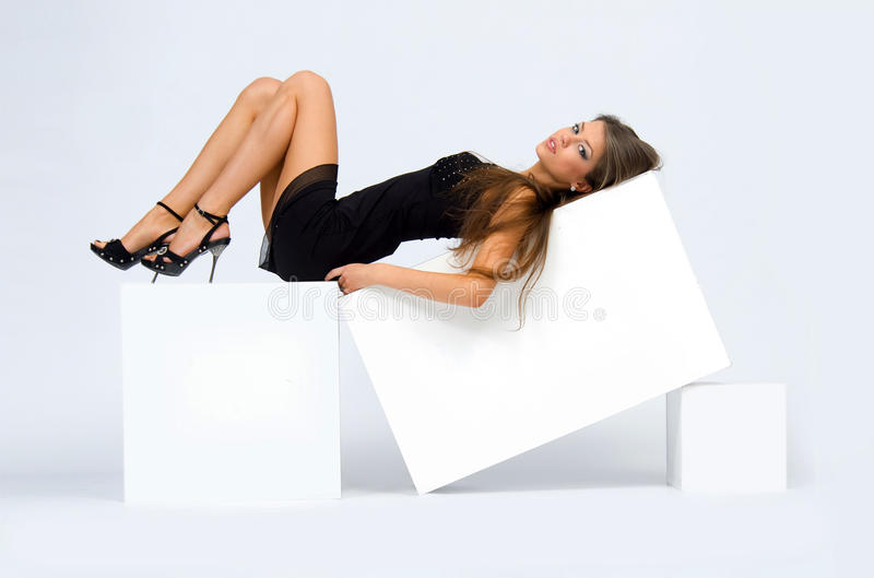 Girl on the cube royalty free stock photography