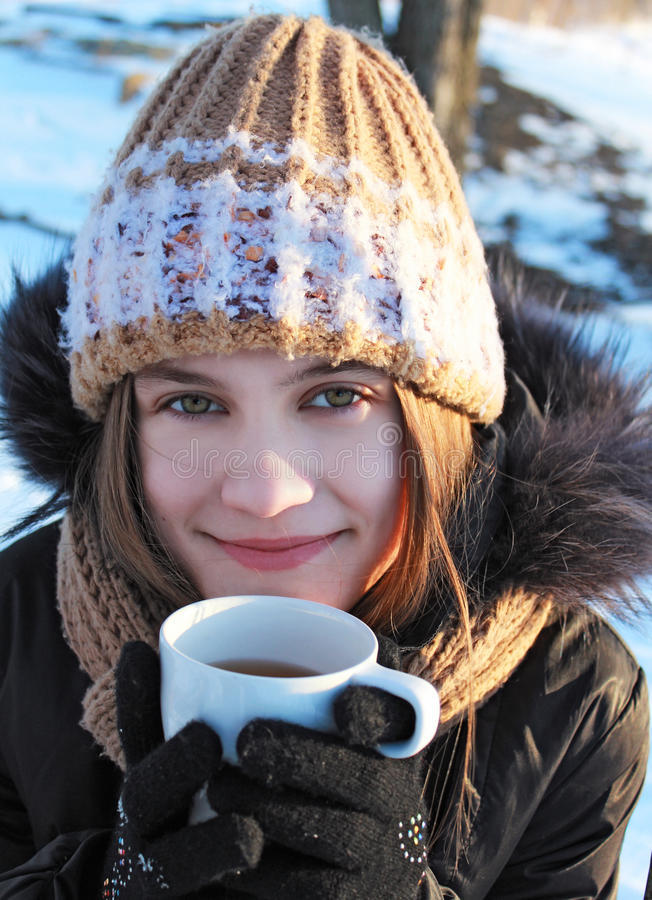 A girl with a cup stock photo