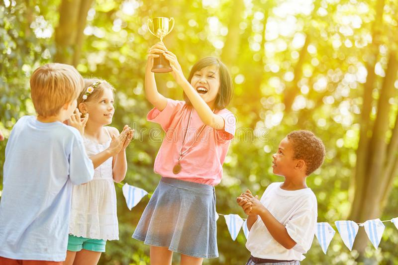 Girl with cup cheers as winner of award ceremony royalty free stock image