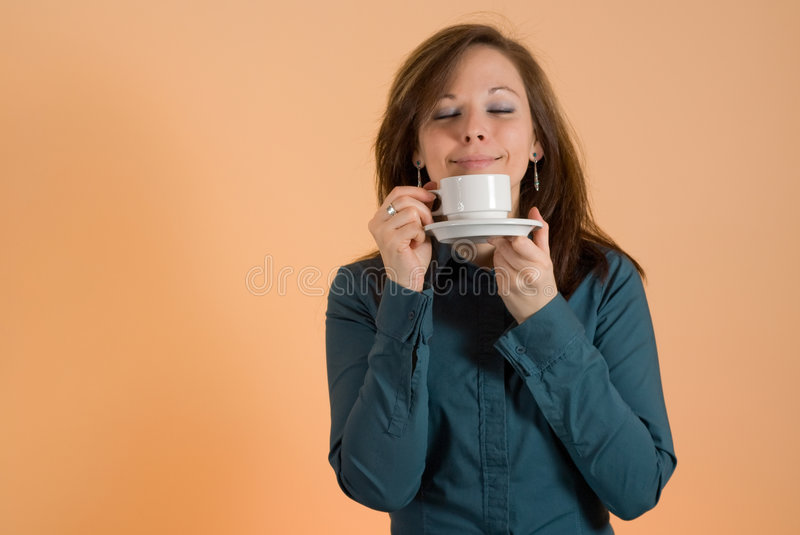 Girl with cup of coffee. Young attractive girl enjoying cup of coffee stock photos