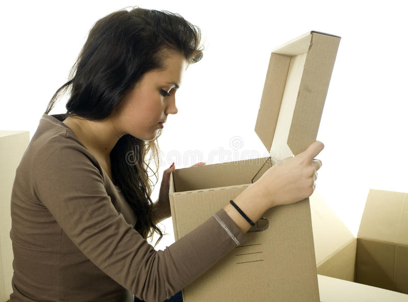 Download Girl With Curiosity Looks To Carton Box Stock Photo - Image of card, hair: 13158938