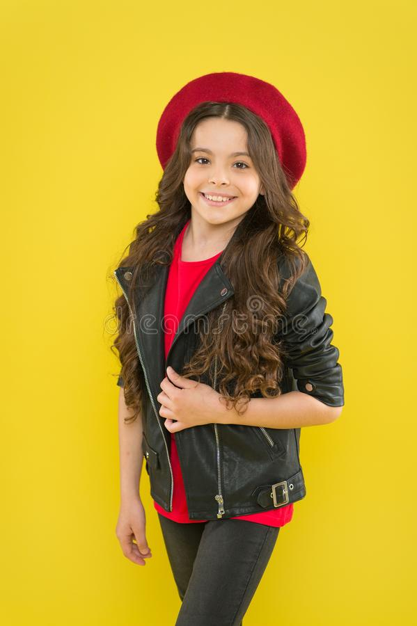 Girl curly hair wear leather jacket. Little rock star concept. Brutal style tender but confident girl. Rock style suits royalty free stock photography