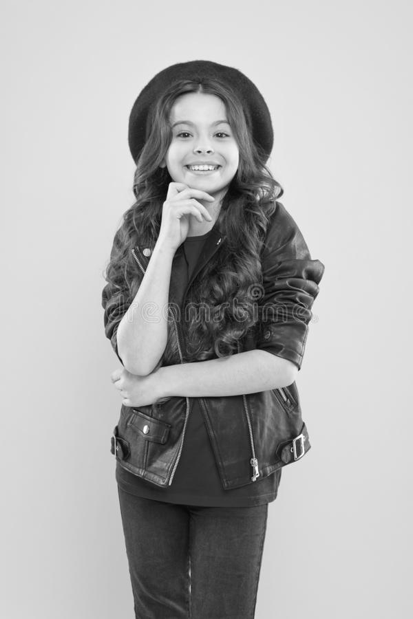 Girl curly hair wear leather jacket. Little rock star concept. Talent contest. Brutal style tender girl. Rock style stock photo