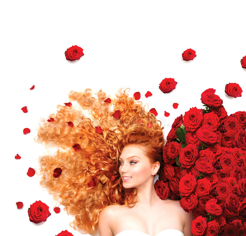 Girl with curly red hair and beautiful red roses. Beauty model girl with curly red hair and beautiful red roses stock photography