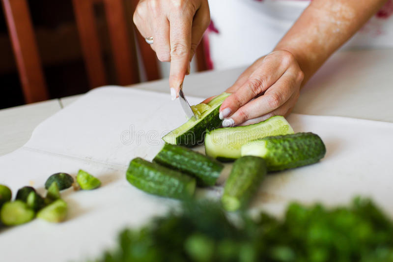 Download Girl cut cucumber stock photo. Image of cooking, food - 28891676