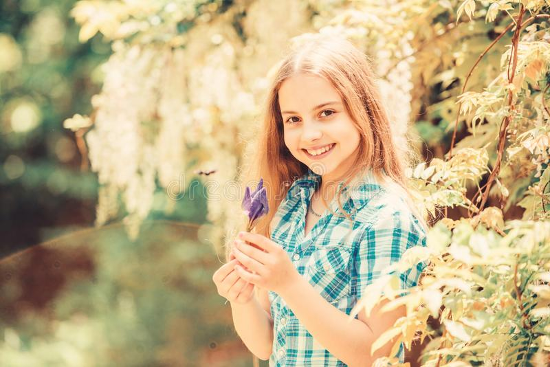 Girl cute adorable teen dressed country rustic style checkered shirt nature background. Summer garden flower. Fresh royalty free stock photography